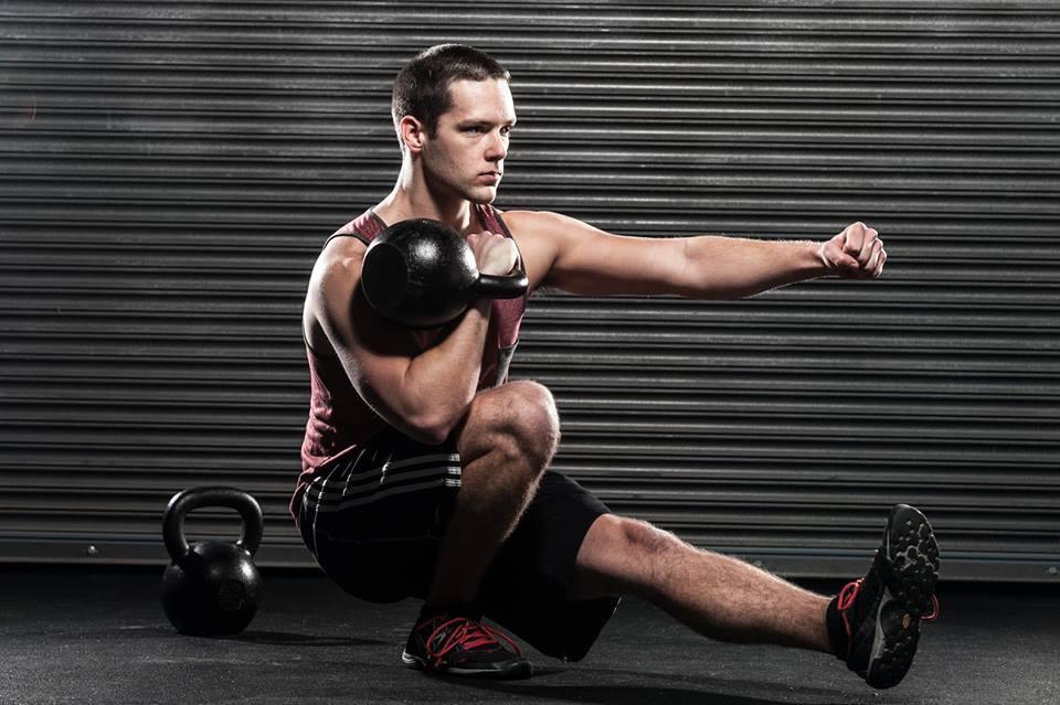 pistol squat with kettlebell